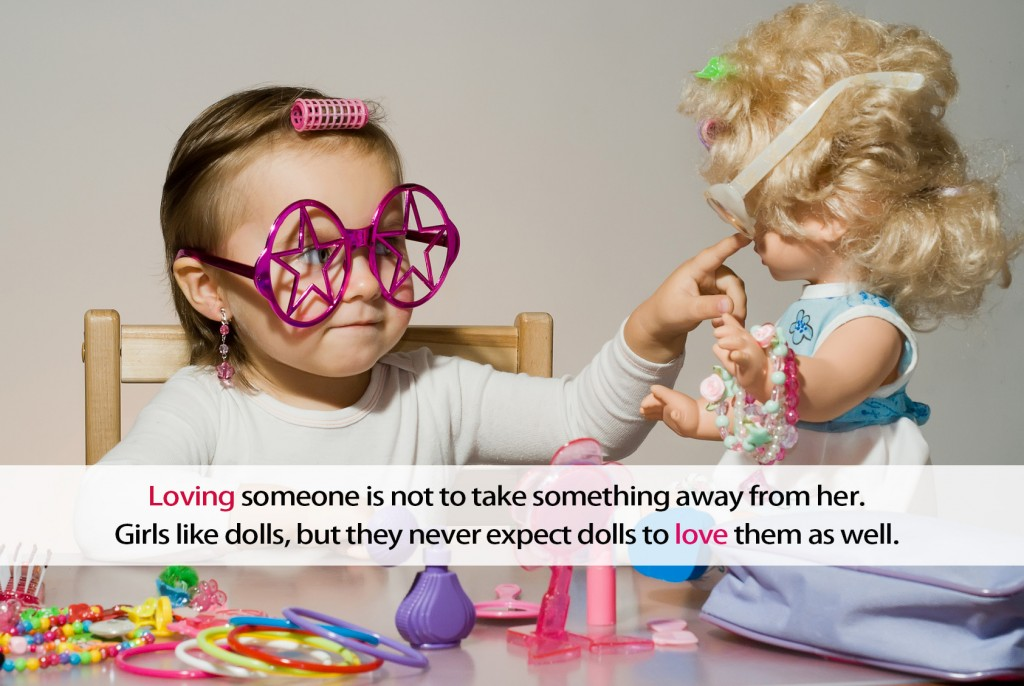 Little adorable girl playing with doll and toy sunglasses